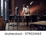 handsome serious tailor in... | Shutterstock . vector #579010465