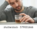 Lonely Depressed Man Drinking...
