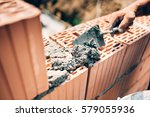 industrial worker using trowel... | Shutterstock . vector #579055936