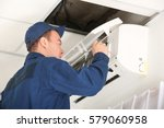 worker carrying out maintenance ... | Shutterstock . vector #579060958