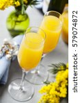Small photo of Two glasses with mimosa cocktail (sparkling wine plus orange juice)