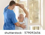 physiotherapist working with... | Shutterstock . vector #579092656