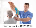 physiotherapist working with... | Shutterstock . vector #579092716