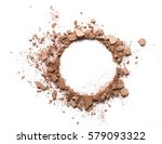 Small photo of Make up crushed powder in the form of a circle on white background. Make up crushed powder on white background. Texture of make up crushed powder isolated on white background