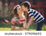 cute little boy  giving present ... | Shutterstock . vector #579098692