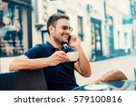 young man drinking coffee and... | Shutterstock . vector #579100816