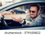 car dealership.young man... | Shutterstock . vector #579100822