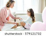 cute little girl putting... | Shutterstock . vector #579121732