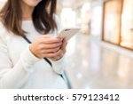 woman typing text message on... | Shutterstock . vector #579123412