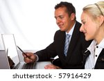 A young business man and woman looking at a computer screen - stock photo