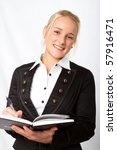 A young businesswoman writing in her diary - stock photo