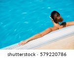 back view of woman relaxing at... | Shutterstock . vector #579220786