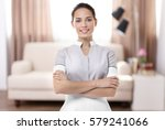 chambermaid standing on living... | Shutterstock . vector #579241066