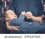 a young mother is sitting on a... | Shutterstock . vector #579247432