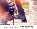 builder puts a tile by tapping... | Shutterstock . vector #579277372
