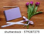 spring flowers on wood... | Shutterstock . vector #579287275