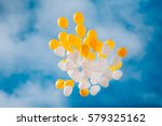 White And Yellow Balloons In...