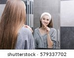 smiling young girl with white... | Shutterstock . vector #579337702