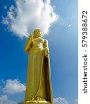 golden standing tall buddha... | Shutterstock . vector #579388672