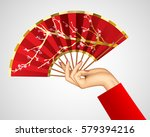 woman's hand with open chinese... | Shutterstock .eps vector #579394216