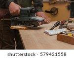 carpenter sanding plank in his... | Shutterstock . vector #579421558