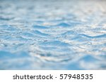 Water surface with tiny ripples and reflecting sunlight.. - stock photo