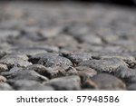 Closeup of a very old walkway made of found stones - stock photo