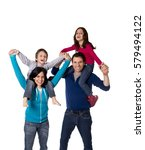 Small photo of young happy family mother and father playing with little son and daughter having fun carrying the children on shoulders all together isolated on white background