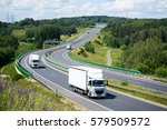 two white small trucks driving... | Shutterstock . vector #579509572