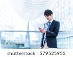 young man holding a smart phone | Shutterstock . vector #579525952