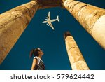 young woman look at airplane... | Shutterstock . vector #579624442