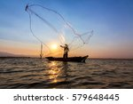 Fishermen Cast Net Into The...