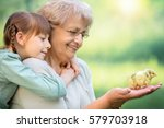 grandmother with grandaughter...   Shutterstock . vector #579703918