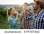 Small photo of Happy people tasting wine in vineyard