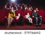 happy family in the movie | Shutterstock . vector #579766642