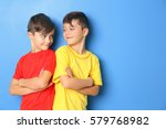twin brothers on blue background | Shutterstock . vector #579768982