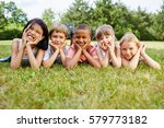 kids as friends at meadow... | Shutterstock . vector #579773182