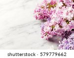 Lilac Flowers On Marble...
