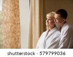 couple in bathrobes after spa... | Shutterstock . vector #579799036