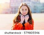 beautiful young woman in orange ... | Shutterstock . vector #579805546