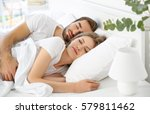 young cute couple sleeping... | Shutterstock . vector #579811462