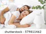 young cute couple sleeping... | Shutterstock . vector #579811462