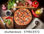 pizza with mushrooms black... | Shutterstock . vector #579815572