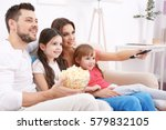 happy family watching tv on... | Shutterstock . vector #579832105