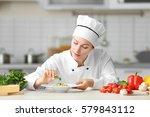 female chef preparing in kitchen | Shutterstock . vector #579843112