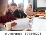 photo of young happy colleagues ... | Shutterstock . vector #579845275