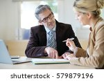 woman meeting notary for advice   Shutterstock . vector #579879196