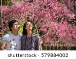 young couple lover traveller... | Shutterstock . vector #579884002