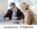 woman meeting notary for advice   Shutterstock . vector #579886306