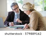 woman meeting notary for advice | Shutterstock . vector #579889162